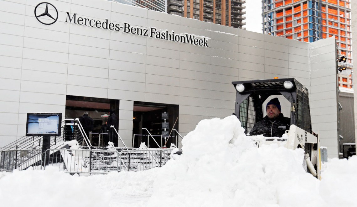 A worker plows snow from the plaza of Lincoln Center, home of New York's Fashion Week shows, Saturday, Feb. 9, 2013. In New York City, the snow total in Central Park was 8.1 inches by 3 a.m. (AP Photo/Richard Drew)