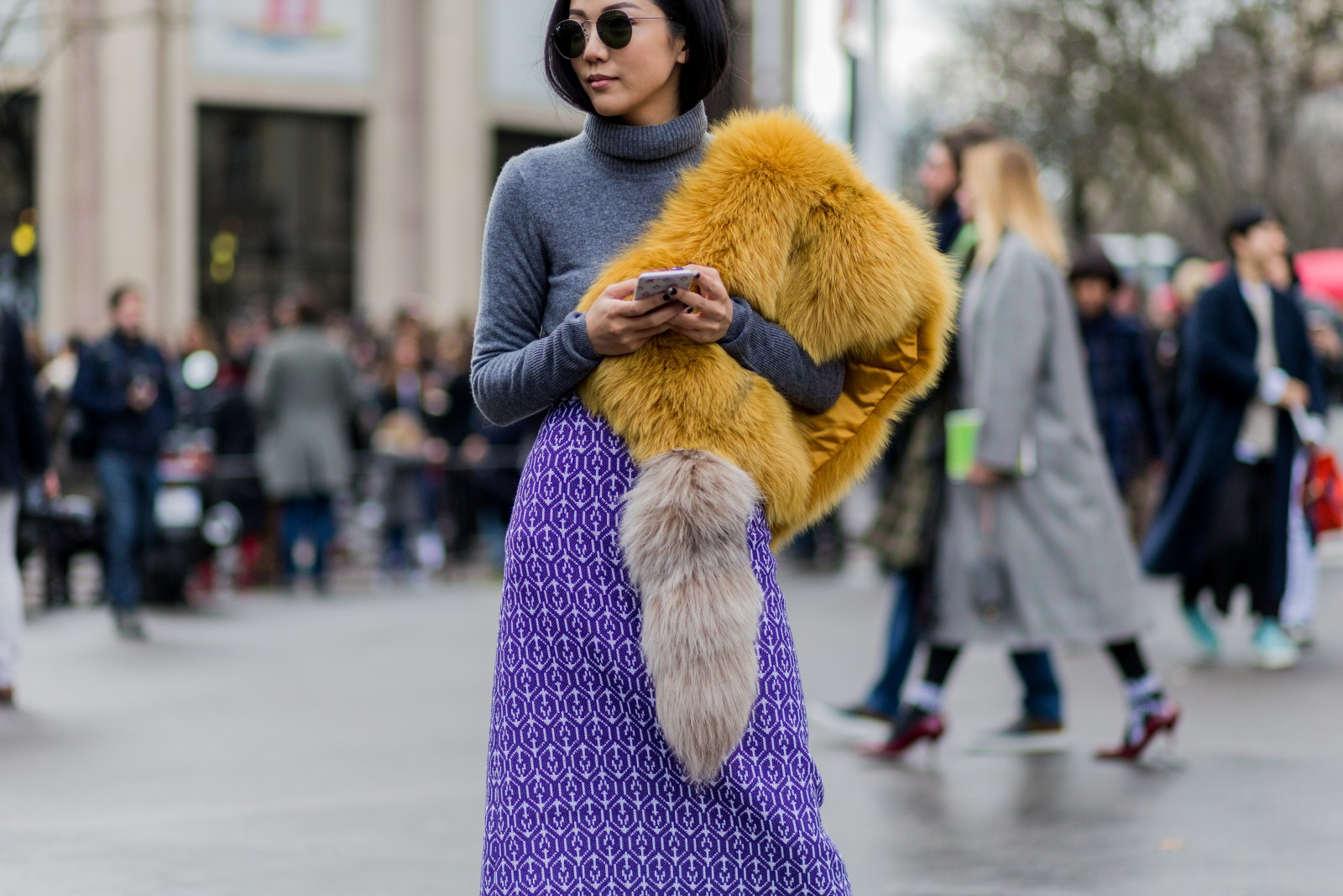 PARIS, FRANCE - March 9:  Yoyo Cao wearing a yellow fur scarf and grey turtleneck and purple skirt outside Miu Miu during the Paris Fashion Week Womenswear Fall/Winter 2016/2017 on March 9, 2016 in Paris, France.  (Photo by Christian Vierig/Getty Images) *** Local Caption ***