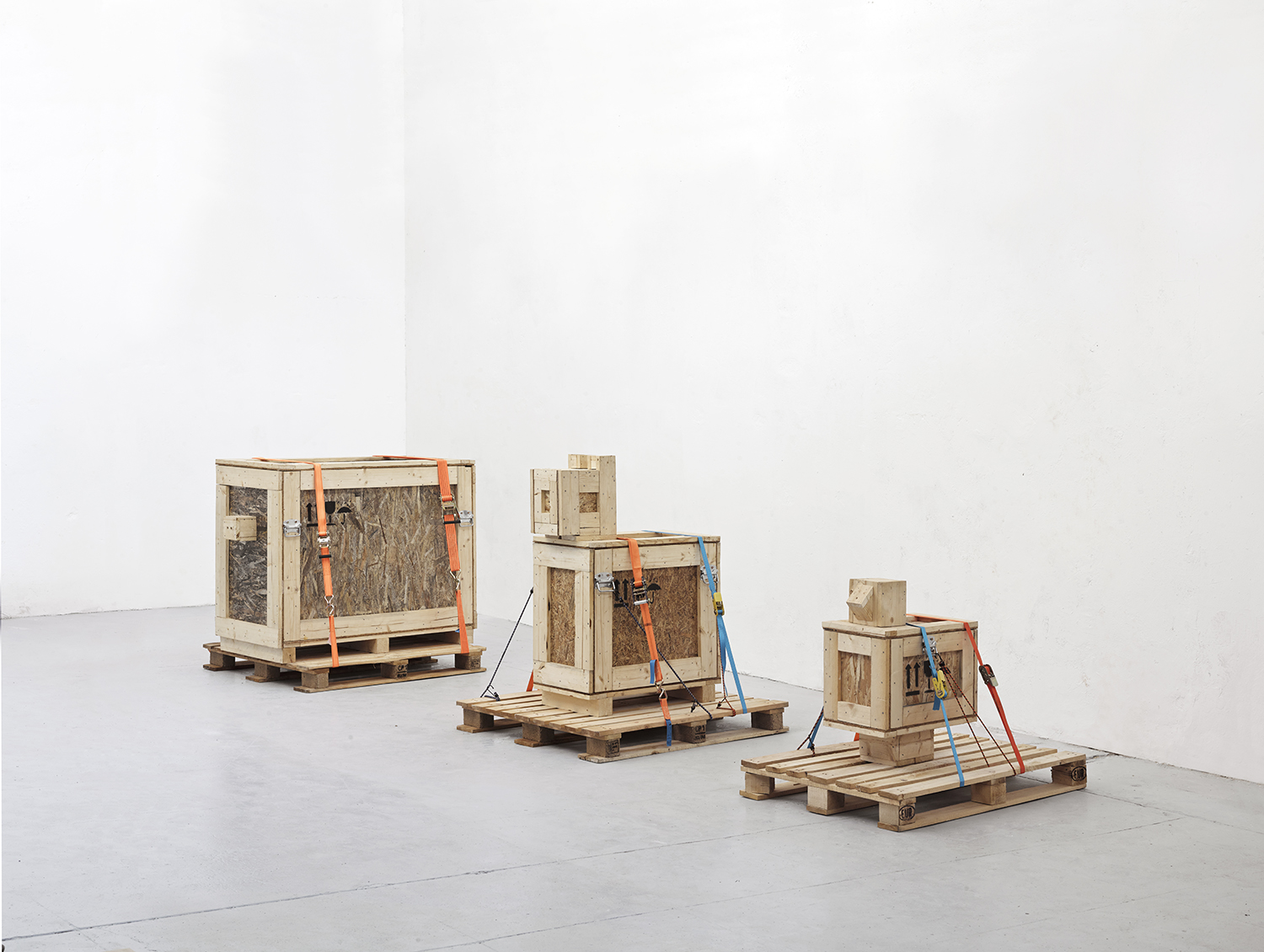 "Dan Vezentan ""Tightening the Straps on the New Rafts"", 2016. Wood, euro pallets, straps, plywood, handles"